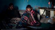 Des migrants dans un refuge improvisé le 8 décembre 2016 dans un entrepôt désaffecté de Belgrade © AFP ANDREJ ISAKOVIC