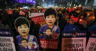 Des portraits de la présidente sud-coréenne Park Geun-Hye lors d'une manifestation demandant sa démission immédiate, le 7 janvier 2017 à Séoul  © AFP/Archives JUNG Yeon-Je